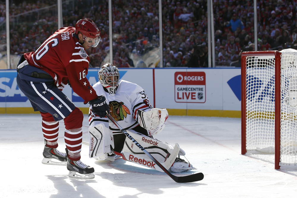 Eric Fehr of the Capitals beats Blackhawks goalie Corey Crawford for a first-period goal Thursday at Washington. The Caps won 3-2 with a goal with 12.9 seconds left.