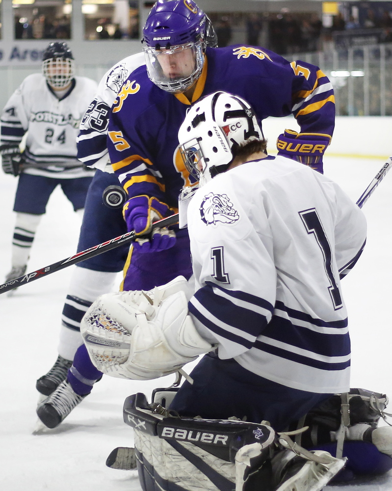 Portland/Deering goalie Alex Girsch makes a point-blank save on Chris Vallee of Cheverus in Thursday's City Cup game at the Troubh Ice Arena in Portland. Vallee scored two goals as the Stags defended their City Cup title with a 7-0 win over Portland/Deering.