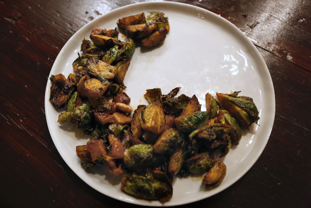 Roasted Brussels sprouts come with salt, pimenton, pork lardons and Marcona almonds.
