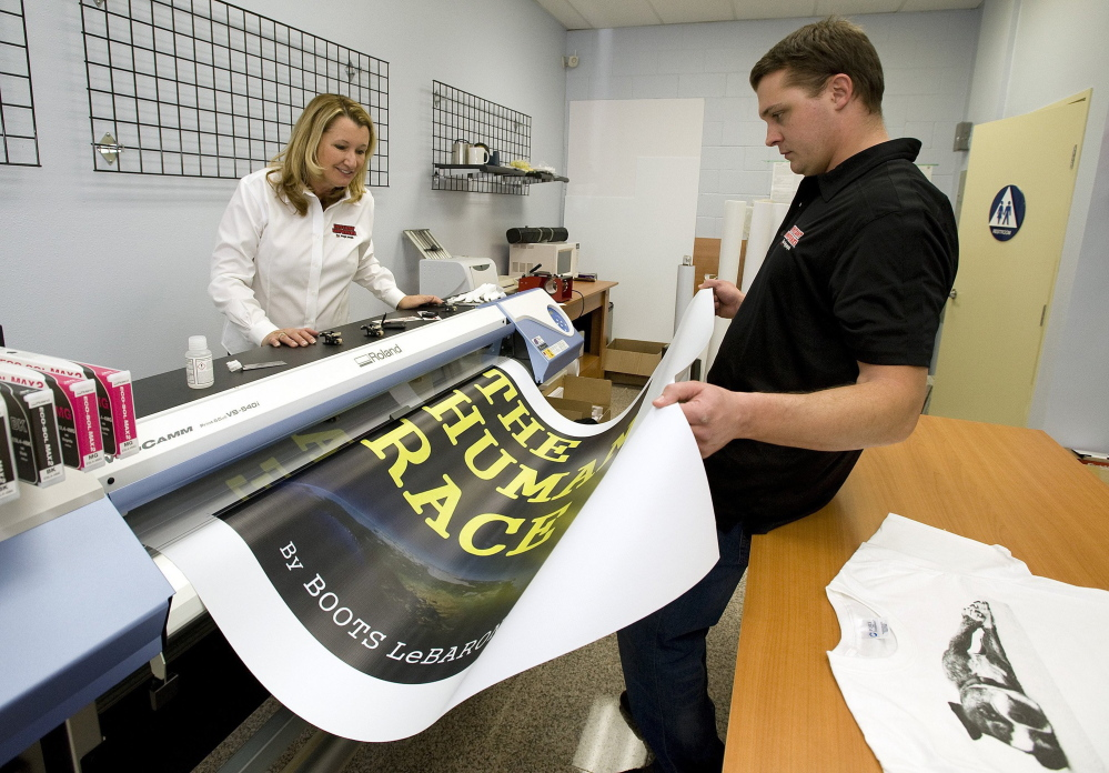Kathy Schneider and son, Steve Schneider, print a banner at Instant Imprints in Fullerton, Calif. People like Kathy Schneider, 57, who started her own business after being downsized from a job in insurance, are helping to make Americans ages 55 to 64 the largest growing age group of entrepreneurs in the U.S.