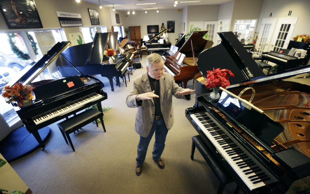 Retailer Jim Foster talks about closing his Foster Family Music Center in Bettendorf, Iowa, last month. When he opened his store 30 years ago, he had 10 competitors who sold just pianos. None of the stores remain.