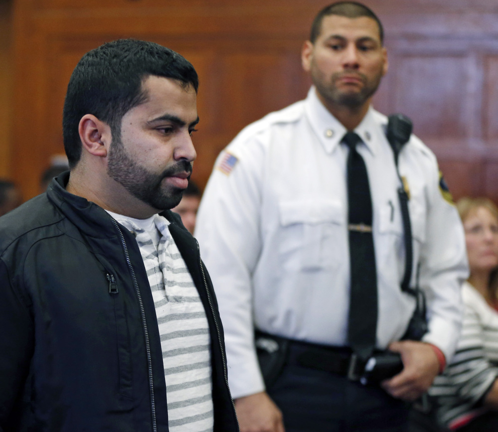 Mohamed Alfageeh, 30, of Boston's Allston neighborhood, stands in Suffolk Superior Court in Boston on Friday. He pleaded guilty to two counts of motor vehicle homicide in the deaths of John Lanzillotti, 28, and Jessica Campbell, 27.