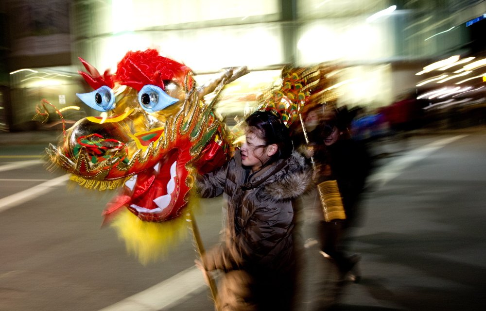 Anna Foo, 14, of Cumberland, manipulates the dragon's head.  In China, the public holiday officially begins Feb. 19 (with Feb. 18 as Chinese New Year's Eve) this year and, according to the Chinese zodiac, 2015 is a year of the goat.