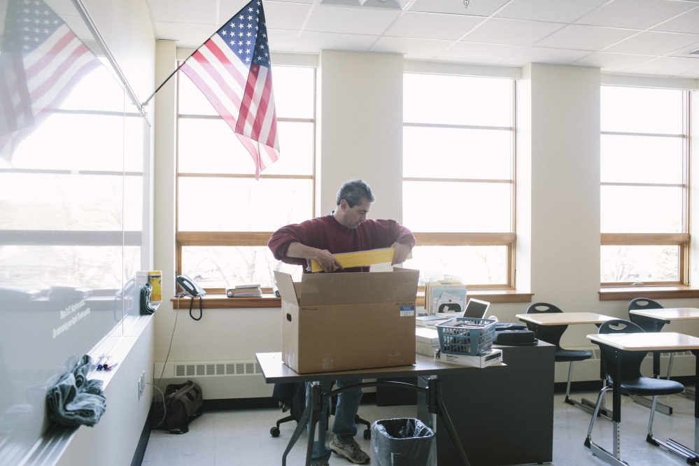 South Portland High School Spanish teacher Henry Coll unpacks a box of materials for his new classroom in a recently completed addition to the school on Friday. His new classroom features additional outlets, storage and technology.