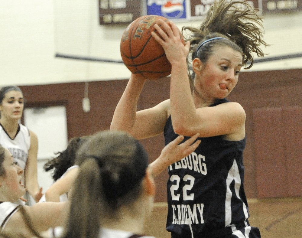 Julia Quinn of Fryeburg Academy emphatically hauls down a rebound Friday night during the Western Maine Conference game in Cumberland. Greely came away with a 39-31 victory, its sixth consecutive win to improve to 6-1. Fryeburg is 3-4.
