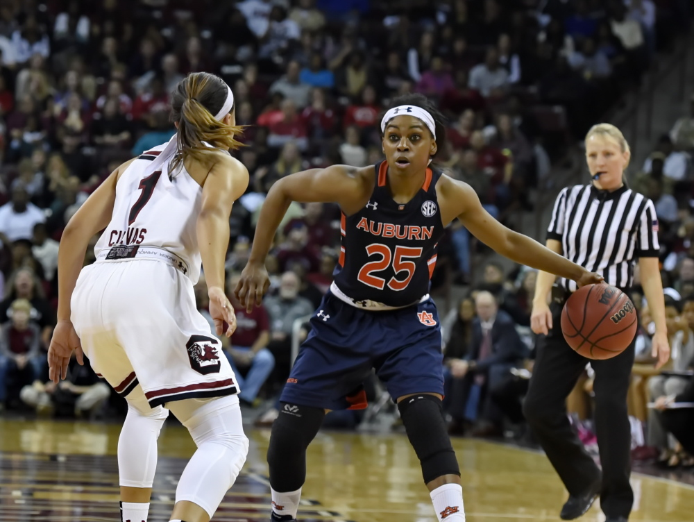 Auburn's Neydja Petithomme, right, looks to make a move while defended by South Carolina's Bianca Cuevas during the second half of South Carolina's 77-58 win Friday at Columbia, S.C. With the win the top-ranked Gamecocks remain undefeated, improving to 13-0.
