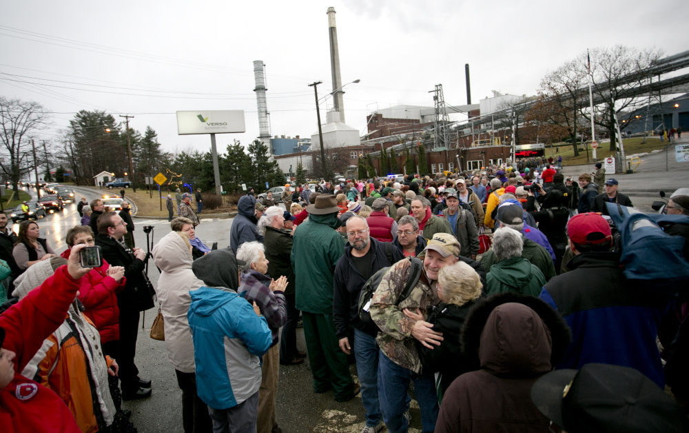 Hundreds of community members greet workers at Verso Paper's Bucksport mill after their final shift on Dec. 17. A union representing millworkers has sued, claiming that the mill is being sold because Verso wants to limit competition as it merges with its biggest rival.