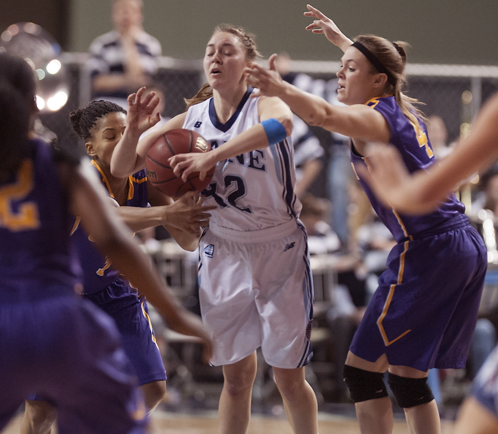Sigi Koizar of Maine attempts to control the ball while fending off pressure from Margarita Rosario, left, and Sarah Royals of Albany in the second half of Albany's 49-43 victory at the Cross Insurance Center.