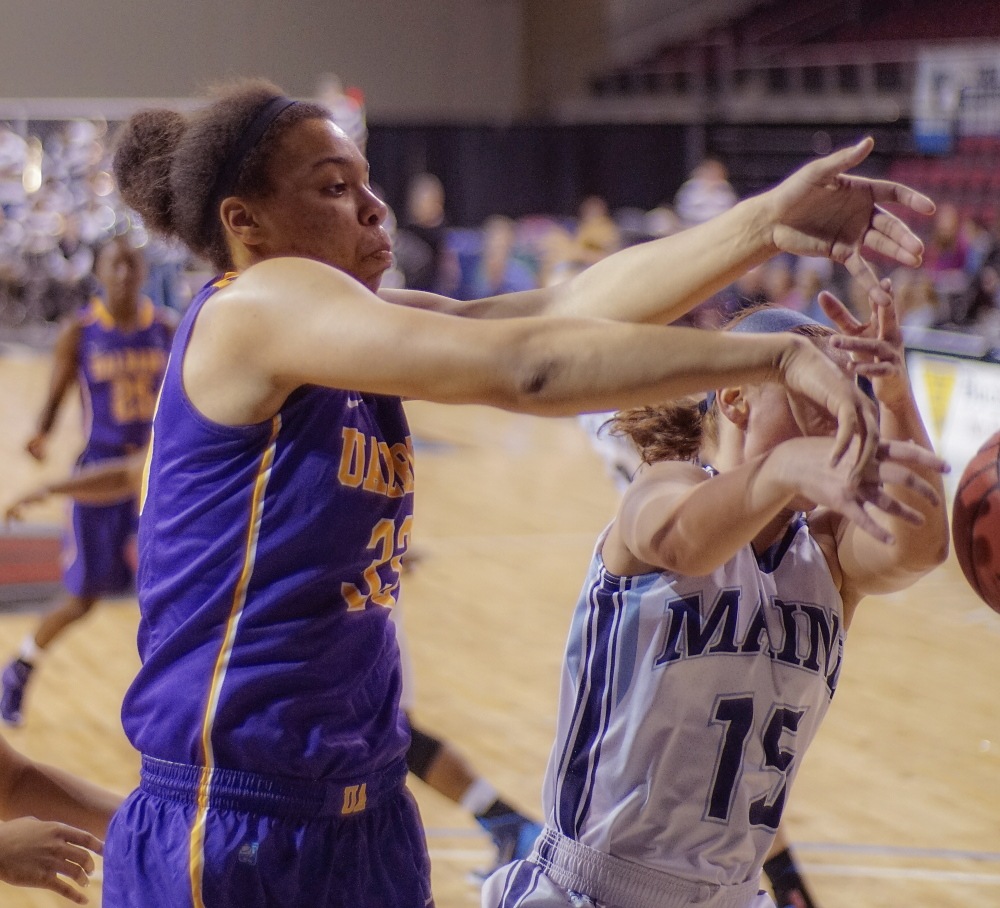 Tiana-Jo Carter, left, who led Lake Region to the Class B state championship last season, scrambles for a loose ball Saturday with Lauren Bodine of Maine. In her freshman year, Carter is averaing 7.6 points and 6.6 rebounds for Albany, with 10 blocks and 11 steals.