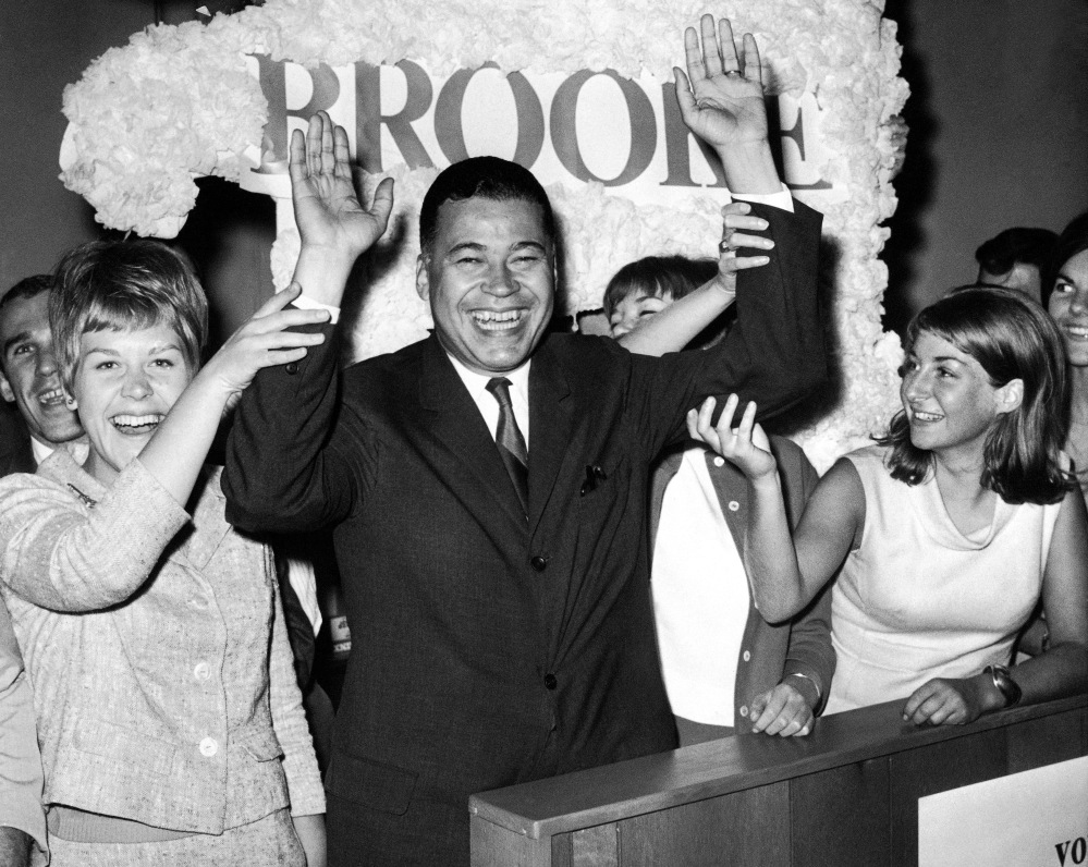 Edward W. Brooke celebrates with campaign workers on Sept. 14, 1966, in Boston after winning the Republican nomination for U.S. Senate.
