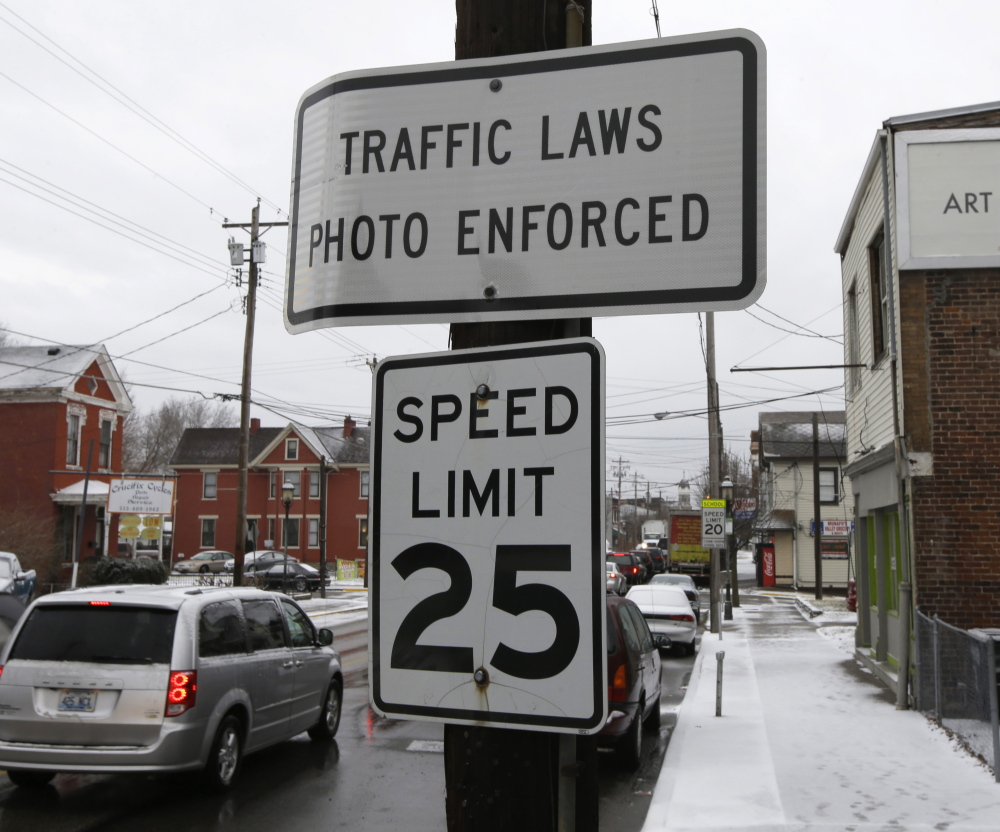 A sign advises motorists that they may be monitored by traffic cameras in Elmwood Place, Ohio, even after the cameras were removed by a Hamilton County judge's ruling.
