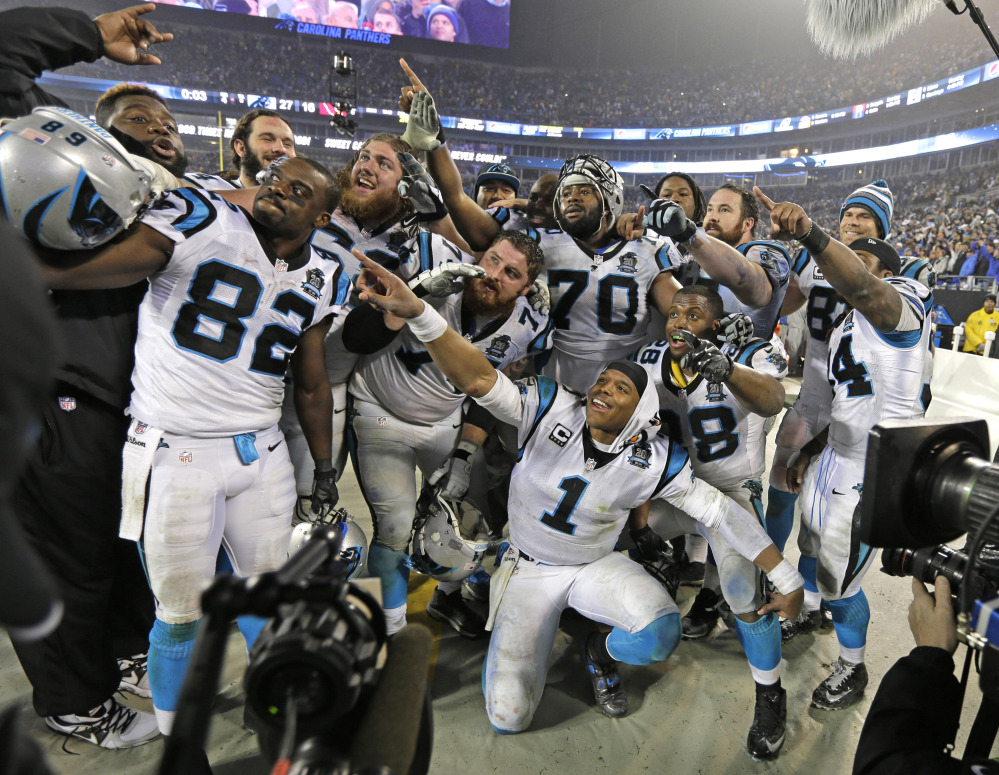 Carolina Panthers players celebrate in the final moments of Saturday's wild card playoff game against the Arizona Cardinals in Charlotte, N.C. The Panthers won 27-16.
