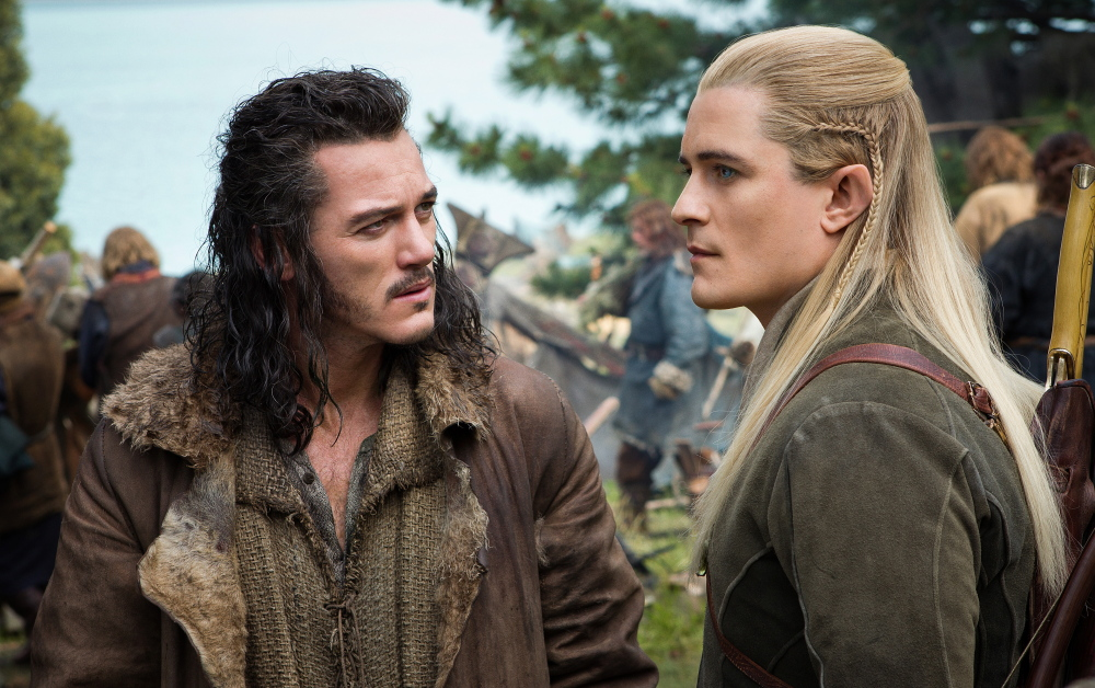 "Luke Evans, left, and Orlando Bloom appear in a scene from ""The Hobbit: The Battle of the Five Armies."""