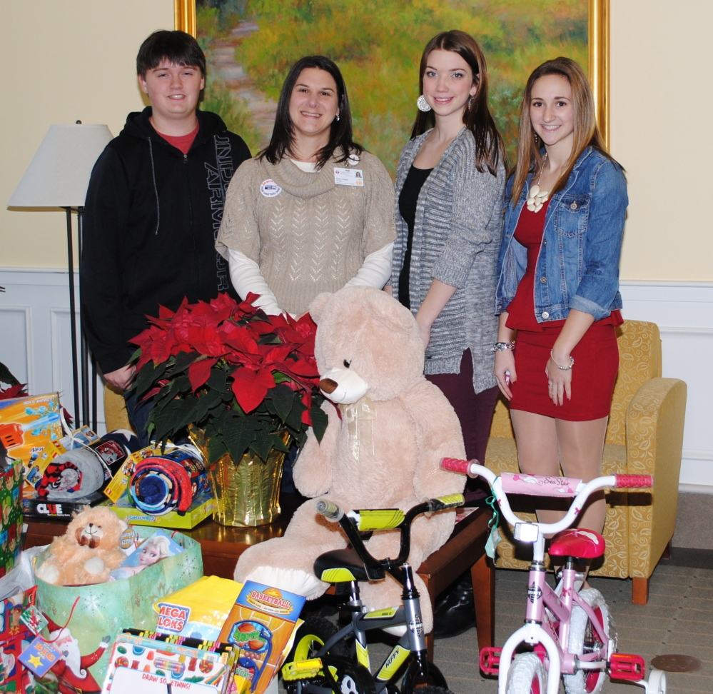 The Biddeford Regional Center of Technology's Student Leadership Council and Biddeford High School's Interact Club donated toys for children at Southern Maine Health Care during Christmas. Karen Chasse, second from left,  Southern Maine Health Care's development manager, accepts toys from Jordan Stickles, left, and Madison Lawlor, co-presidents of the council and and Sami Pinard, right, vice president.
