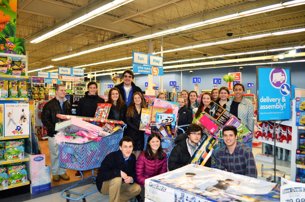 Berwick  Academy students set a record by raising $2,400 to fulfill Toys for Tots requests in 2014. This marks the 20th year that students have participated in the program of helping to fulfill the Christmas wishes of needy residents by adopting star gift requests from the town's Christmas tree. Photo courtesy Tracey Boucher