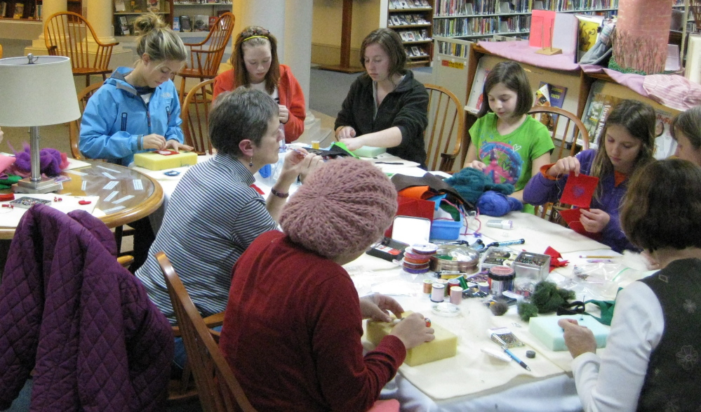 Participants work on projects at a needle felting workshop. A new felting class will be offered at the Camden Public Library on Tuesday.