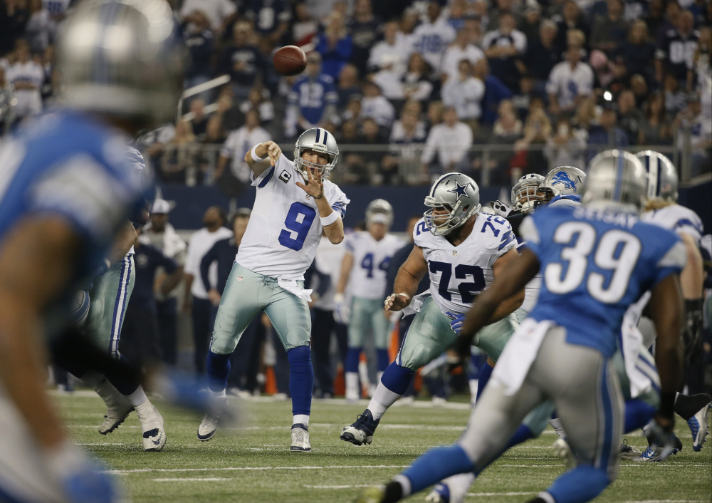 Dallas Cowboys quarterback Tony Romo (9) throws a pass during the second half of an NFL wildcard playoff football game against the Detroit Lions, Sunday, in Arlington, Texas.