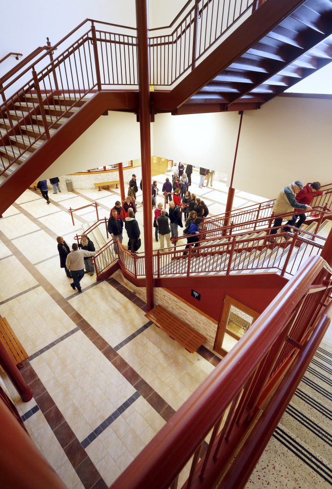 People visit during an open house Sunday at South Portland High School to view the completed $47.3 million renovation and expansion.