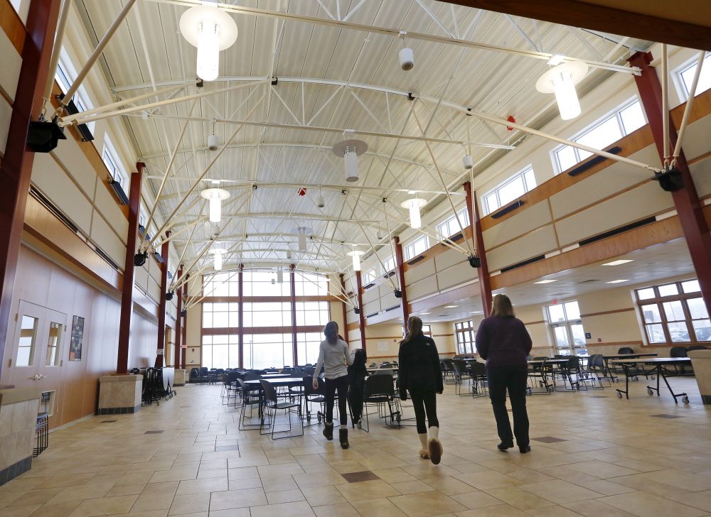 People visit the new cafeteria during an open house Sunday at South Portland High School to view the completed $47.3 million renovation and expansion. The construction process lasted nearly three years.