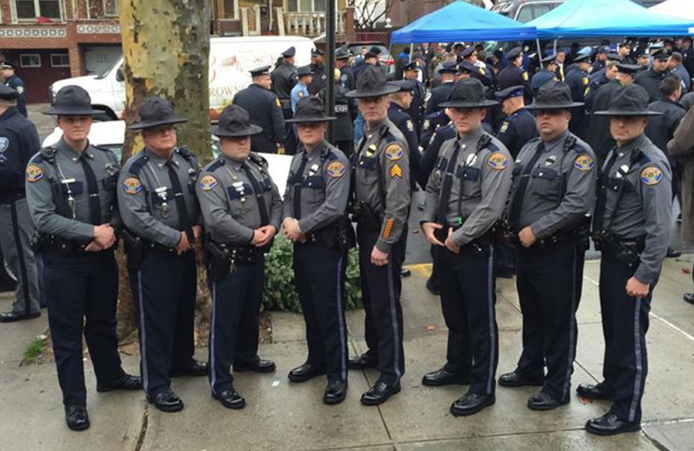 Eight Scarborough officers were among those who attended the funeral Sunday in New York. From left to right, reserve officer Matthew Dahms, Patrolman John Gill, Patrolman Craig Hebert, Patrolman Scott Vaughan,  Sgt. John O'Malley, Patrolman Austin Clark, Scarborough police dispatcher and reserve officer Joseph Thornton and Patrolman Michael Beeler.