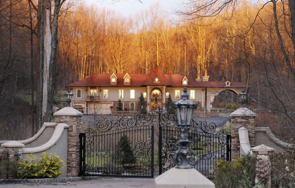 "A bright sunrise shines on the home of Teresa Giudice, a cast member of Bravo's ""Real Housewives of New Jersey,"" and her husband Giuseppe ""Joe"" Giudice Monday, in the Towaco section of Montville Township, N.J."