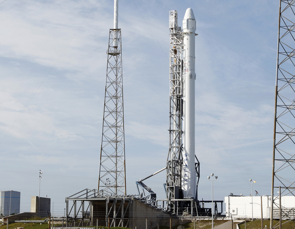 The Associated Press A Falcon 9 rocket carrying the SpaceX Dragon spacecraft is seen at launch complex 40 after an attempted early morning launch was scrubbed due to technical issues at the Cape Canaveral Air Force Station in Cape Canaveral, Fla. on Tuesday.