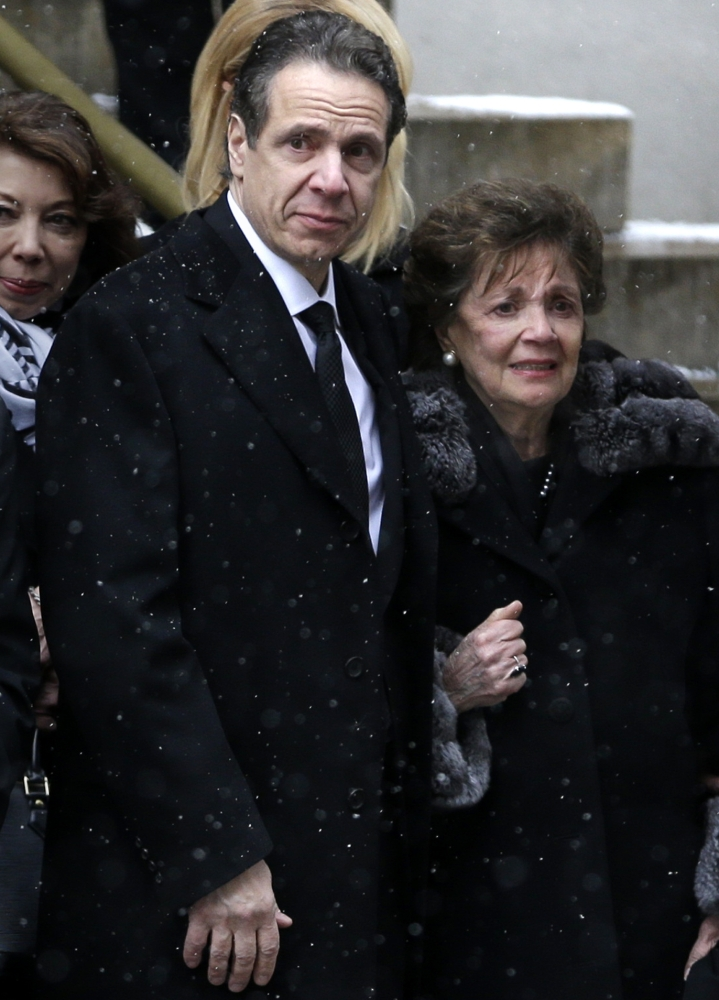 New York Gov. Andrew Cuomo and his mother, Matilda, watch as the body of Mario Cuomo is loaded into a hearse at his funeral in New York on Tuesday.