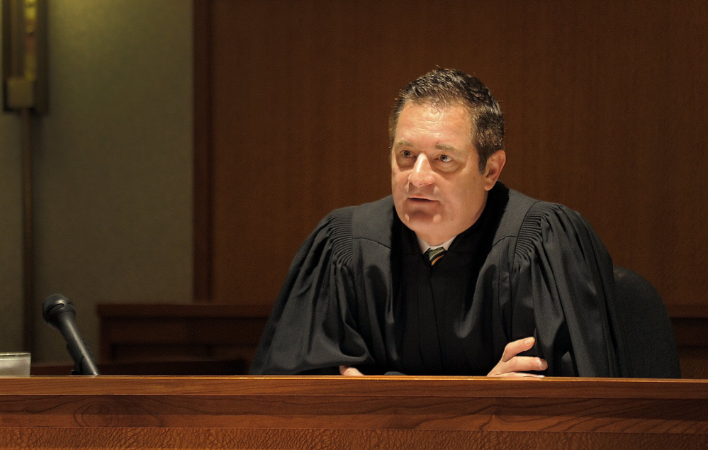 Judge Jeffrey Moskowitz addresses a client during a drug court session in Cumberland County Superior Court in 2013. The judge made a controversial ruling this week when he ordered the media not to report on witness testimony in a high-profile case.