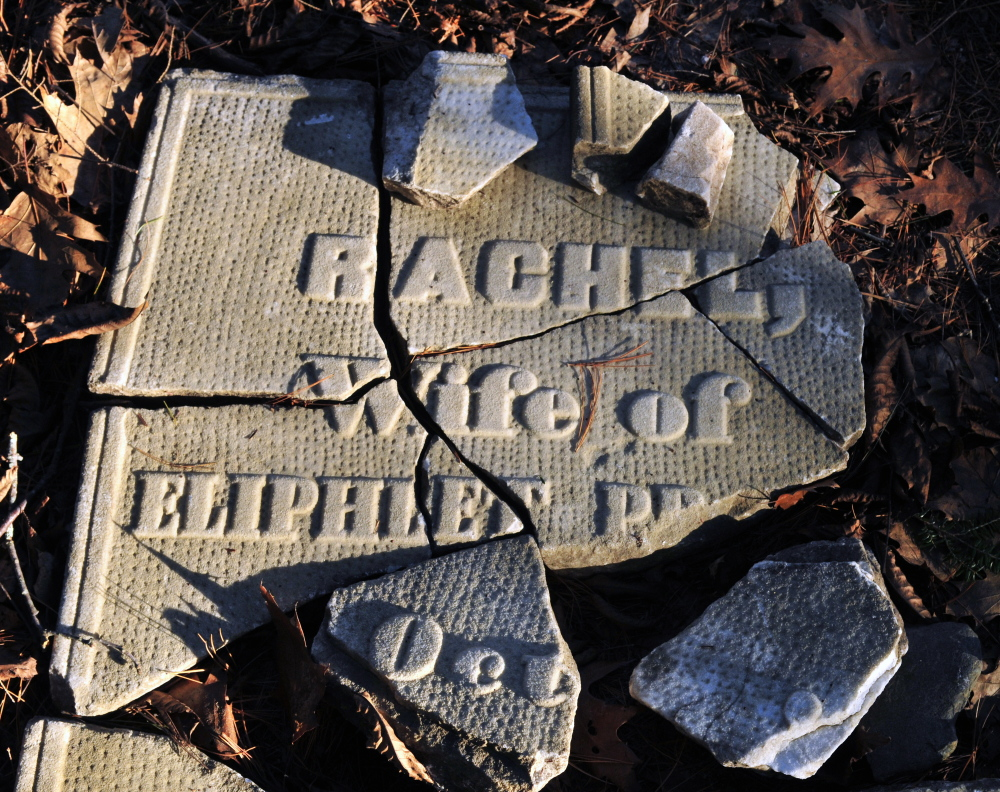Pieces of broken tombstone sit on the ground in the Edgecomb cemetery last week in Gardiner.