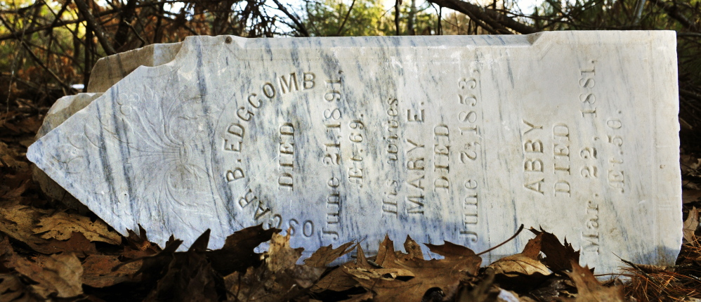 This obelisk grave marker with names on all four sides sits toppled at the bottom of the hill at Edgecomb cemetery in Gardiner.