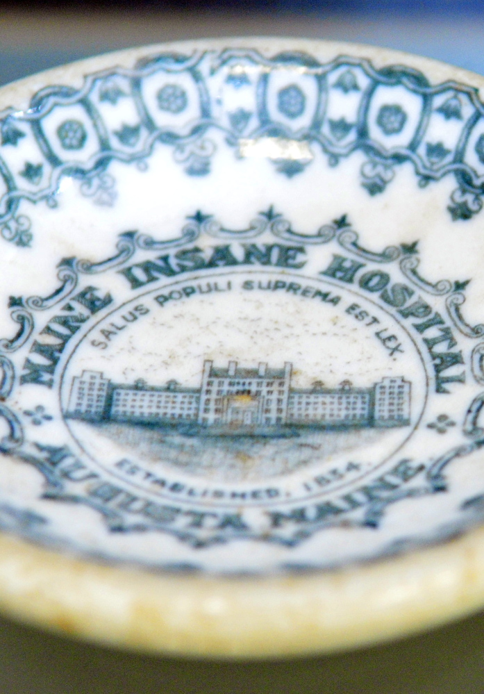 A dish from the Maine Insane Hospital – which later became Riverview Psychiatric Center – is a part of the exhibit which opens next week at the Holocaust and Human Rights Center.