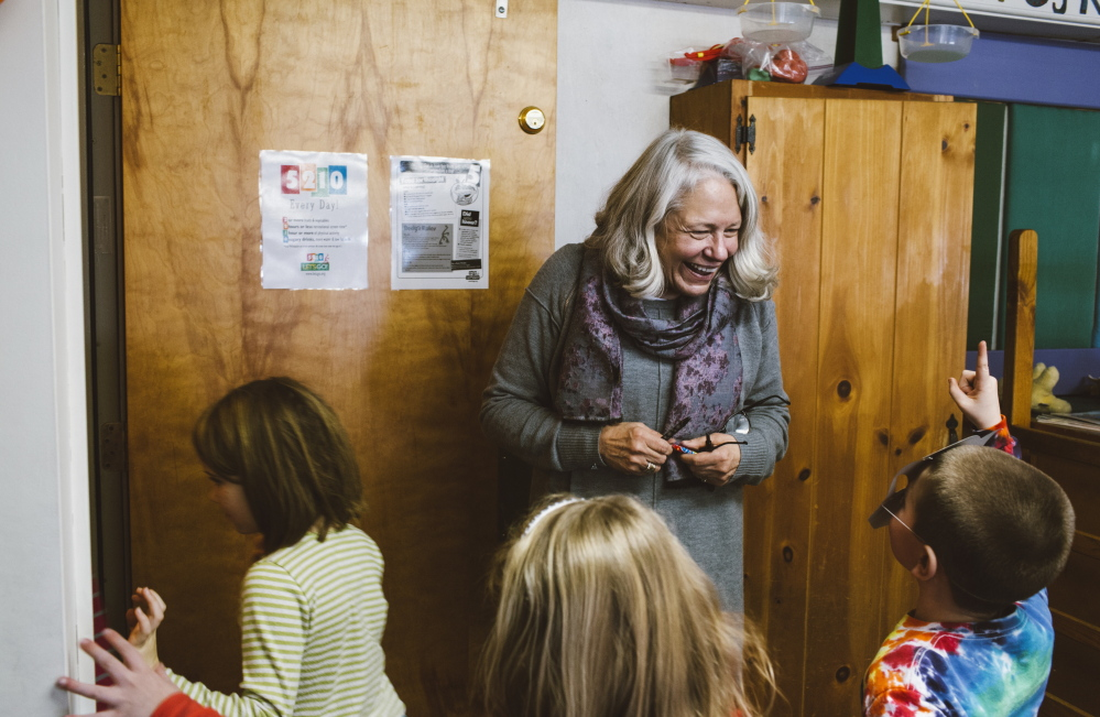 "In this Jan. 6, 2015, photo teacher Nancie Atwell mingles as recess ends and students head to the rest of the day's classes at the Center for Teaching and Learning, which she founded in the coastal town of Edgecomb. Atwell says teaching is ""pure pleasure. It's like eating dessert all day long."""