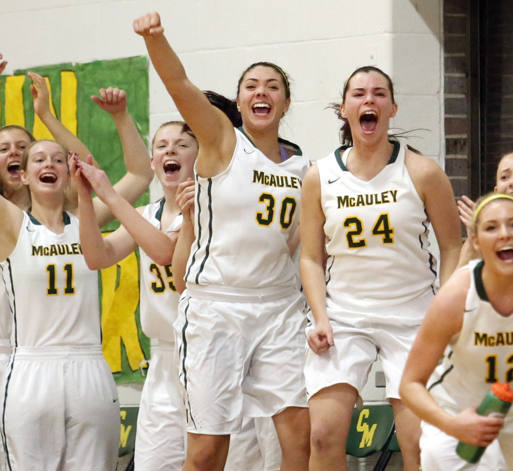 Kaeli Leddy, 30, and Amanda Spink, 24, lead the cheers after a late basket helped once-beaten McAuley send Thornton Academy to its first loss.