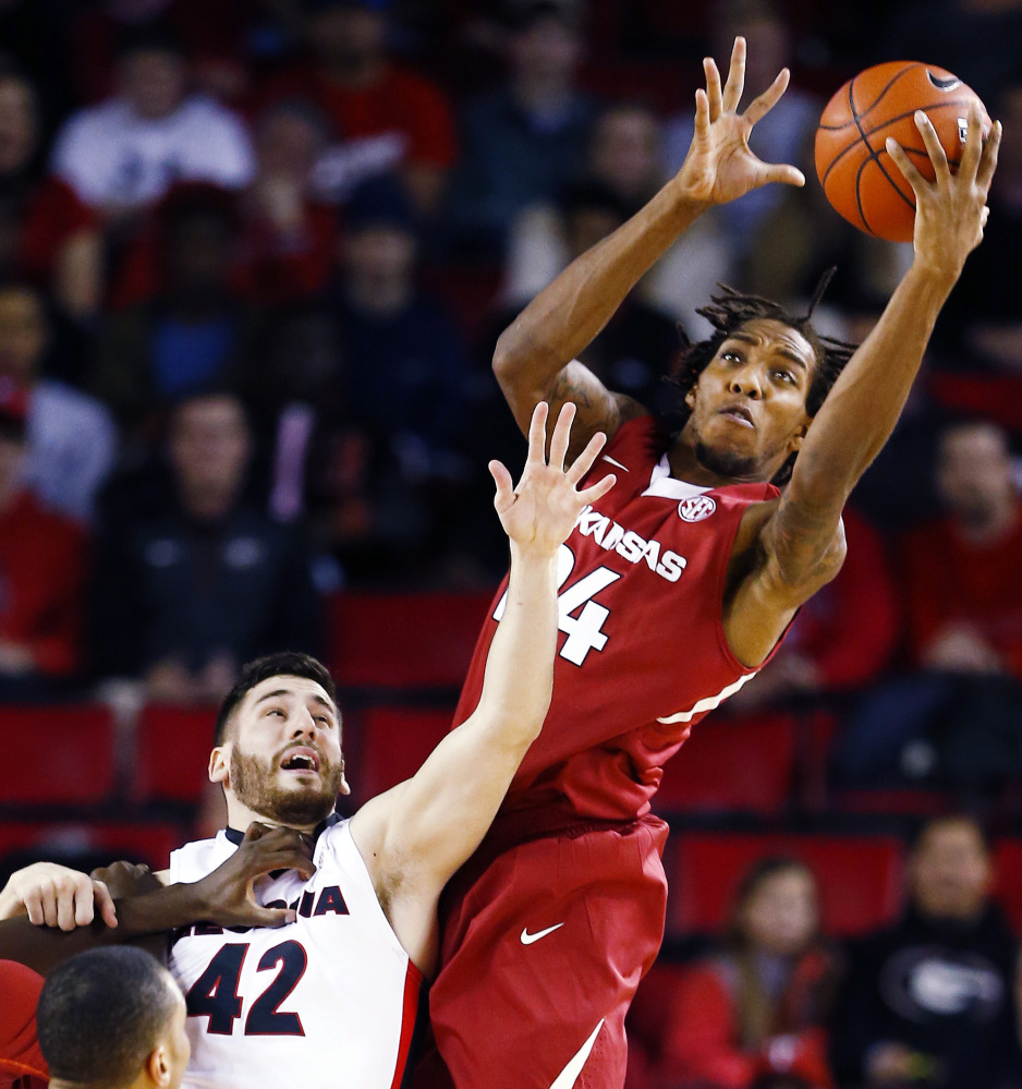 Arkansas guard Michael Qualls, right, and Georgia forward Nemanja Djurisic battle for a rebound during the Razorbacks' 79-75 win Tuesday in Athens, Georgia.