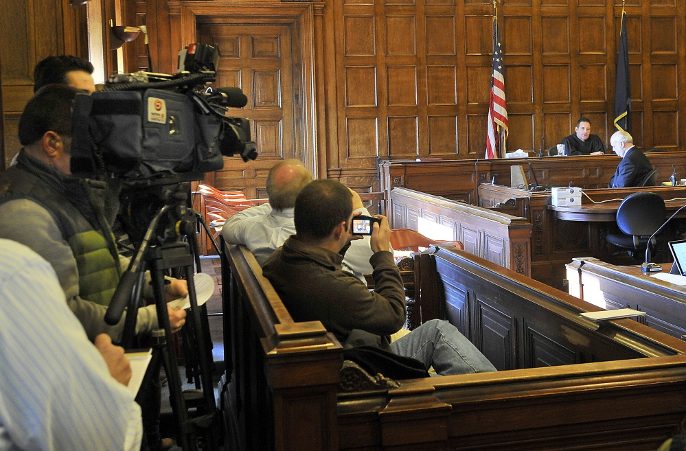 During a court hearing Wednesday before a crowd of about 35 people, mostly journalists and curious lawyers, Judge Jeffrey Moskowitz apologized to the media for issuing a gag order Monday restricting reporting on a Standish attorney's domestic assault case.