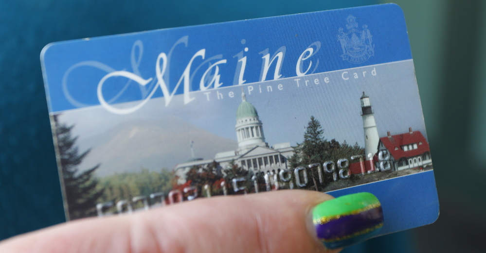 Maine officials and the federal government are at odds over the use of photos on the cards used to access food stamps and in-person interviews for those re-applying for food assistance.