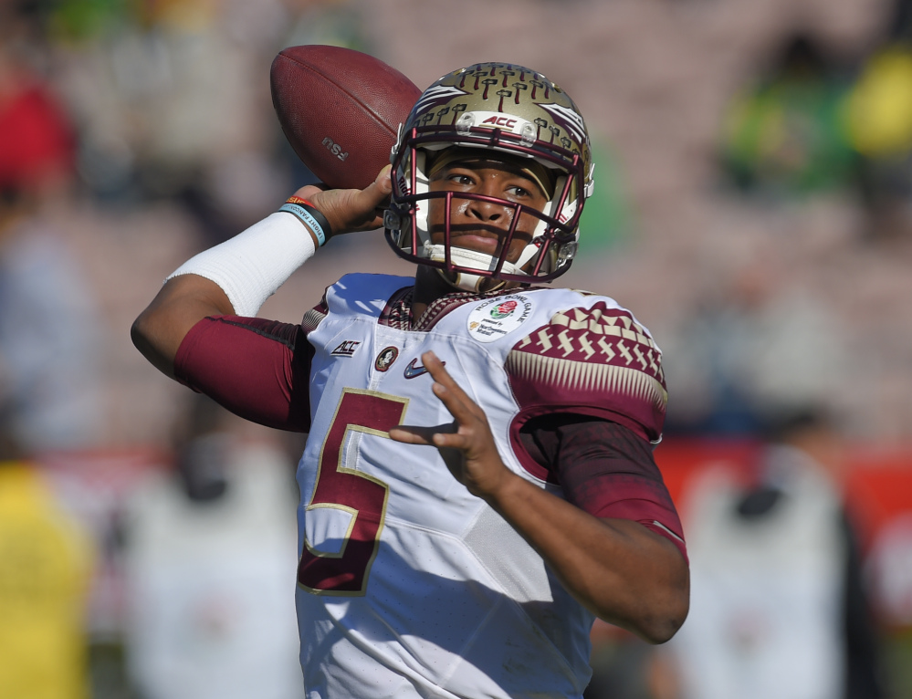 Florida State quarterback Jameis Winston, show in the Rose Bowl game on Jan. 1, declared himself eligible for the NFL draft Wednesday, with two years of college eligibility remaining. Also Wednesday, the woman who accused Winston of rape filed a lawsuit against the university saying it failed to properly investigate her allegations.