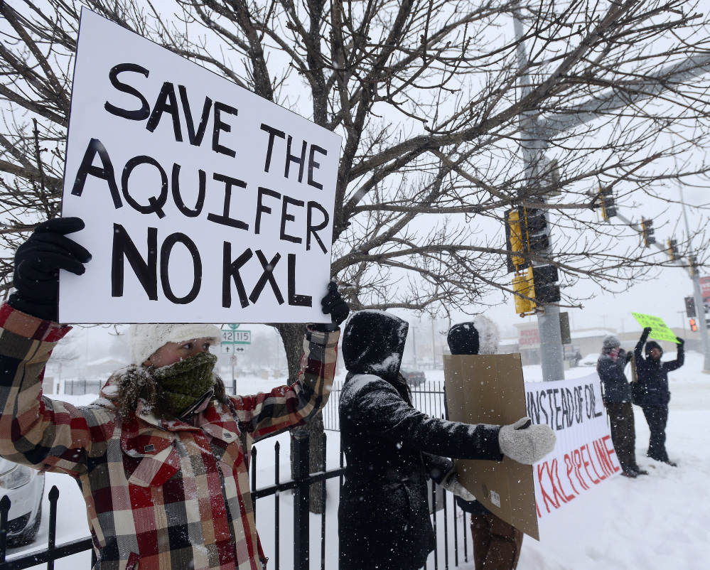 Demonstrators in Sioux Falls, S.D., protest the proposed pipeline. Lawsuits are being considered on behalf of Native American tribes in South Dakota.