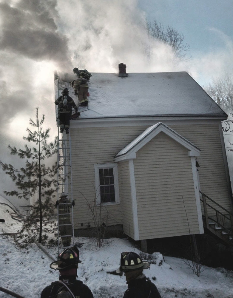 Firefighters battle a fire that destroyed a house at 4 Libby Court in Bath on Thursday morning.