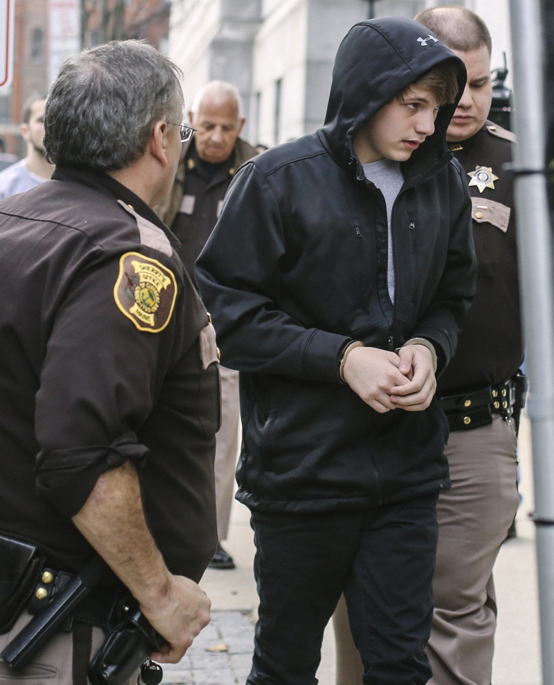Justin Woodbury, shown during his initial court appearance on Dec. 18, denied terrorism charges on Thursday.
