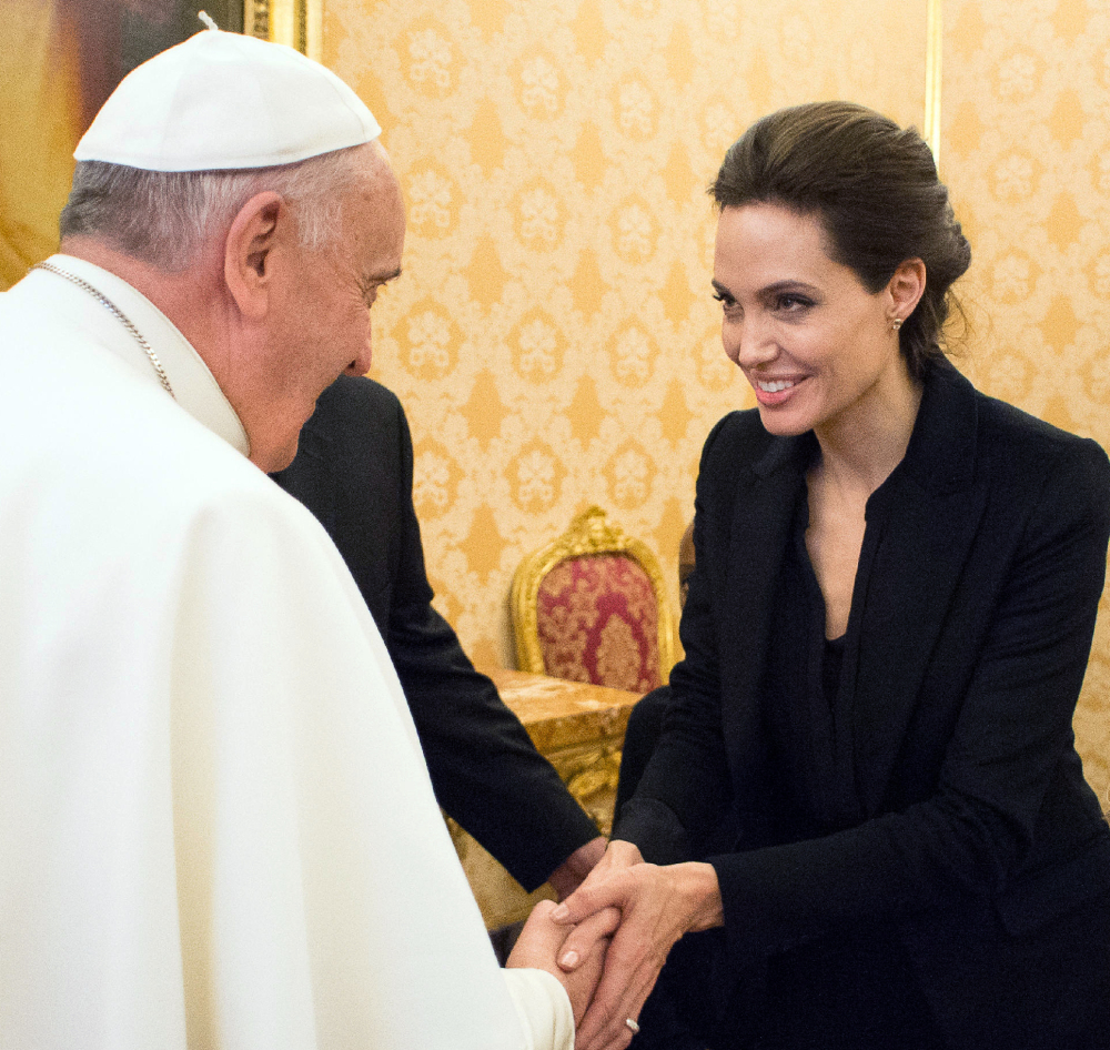 "Pope Francis meets Angelina Jolie during a private audience at the Vatican, Thursday, after a screening of her film, ""Unbroken,"" a survival story."