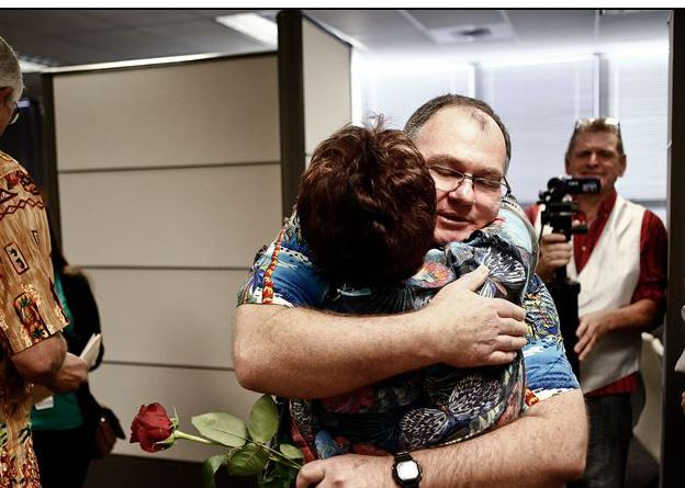 Ross Griffith, right, is congratulated by Arlene Goldberg on Tuesday after Griffith married his partner in Fort Myers, Fla. The U.S. Supreme Court could decide as early as Friday to take up the issue.