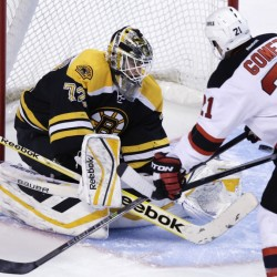 Boston Bruins goalie Niklas Svedberg makes a save as New Jersey Devils center Scott Gomez looks for the rebound during the first period of Thursday night's 3-0 win by the Bruins in Boston.
