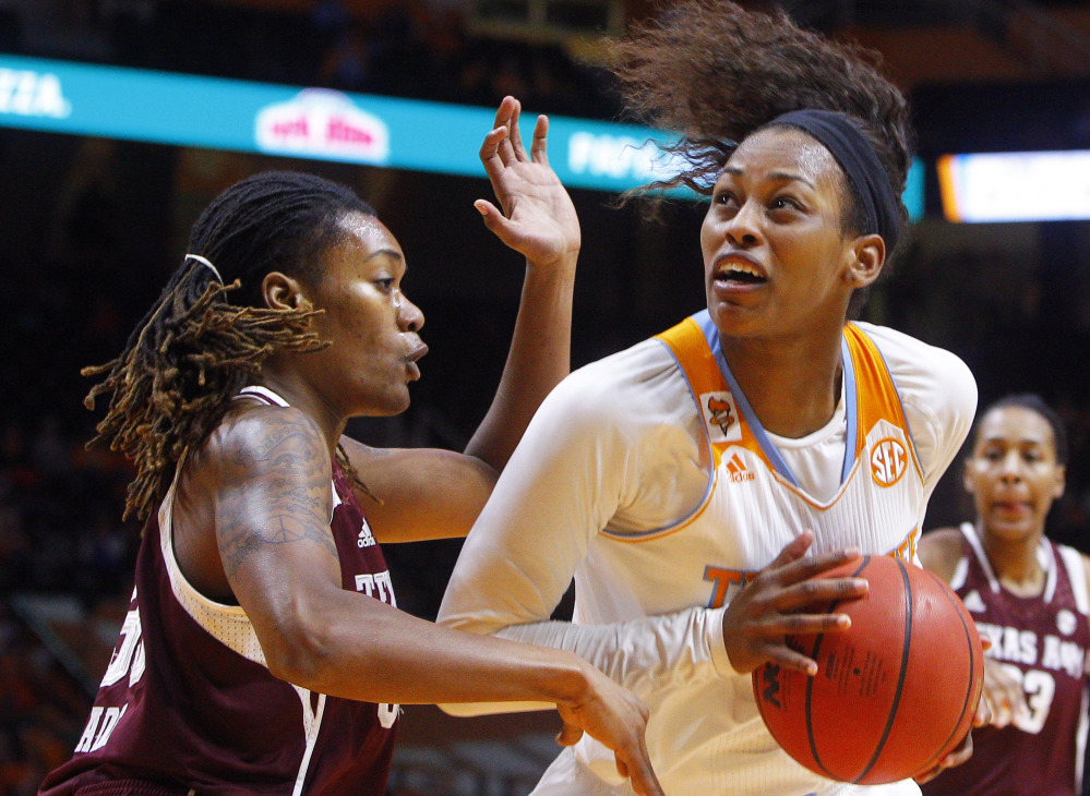Tennessee's Bashaara Graves works the ball against Texas A&M forward Achiri Ade in the first half  of Thursday's game, won by the Volunteers.