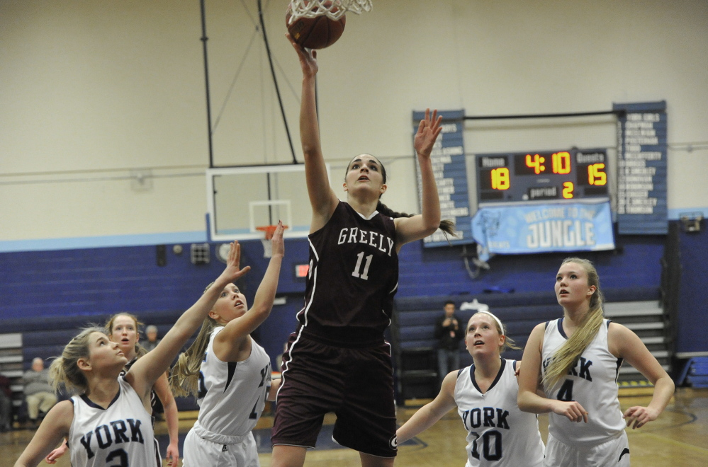 Greely's Ashley Storey goes for a layup as, from left, York's Paige McElwain, Madigan Cogger, Mia Briggs and Shannon Todd look on during Thursday's game at York. The hosts won 48-43.