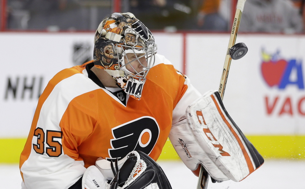 Philadelphia goalie Steve Mason blocks a shot during the first period of Thursday's game against the Washington Capitals. Jakub Voracek scored in overtime to give the Flyers a 3-2 win.