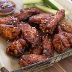 Korean-style chicken wings are made with gochujang, which in Korean cooking is used as a base for stews and marinades, as well as a feisty condiment for one-pot dishes such as bibimbap. (AP Photo/Matthew Mead)