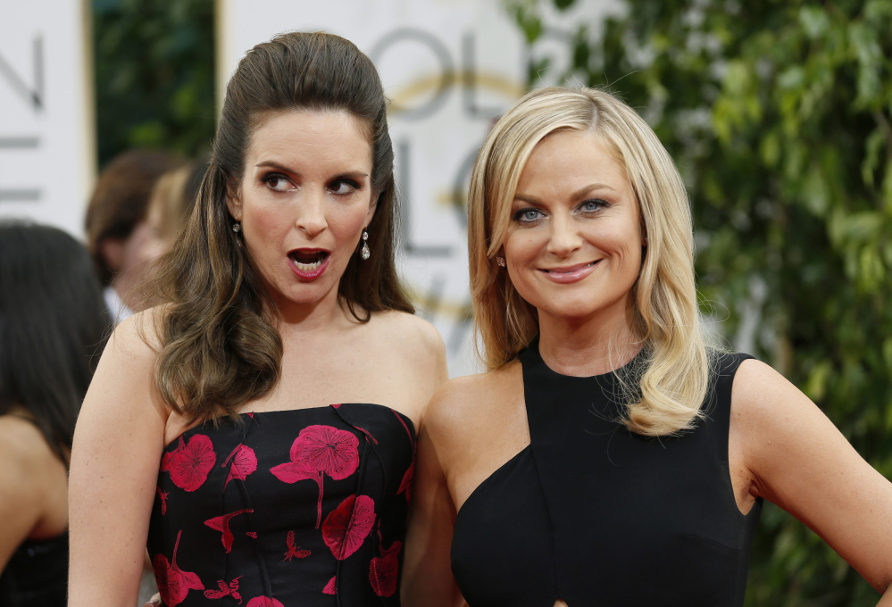 Tina Fey, left, and Amy Poehler return to host the Golden Globe Awards ceremony for the third – and, they say, final – time on Sunday.