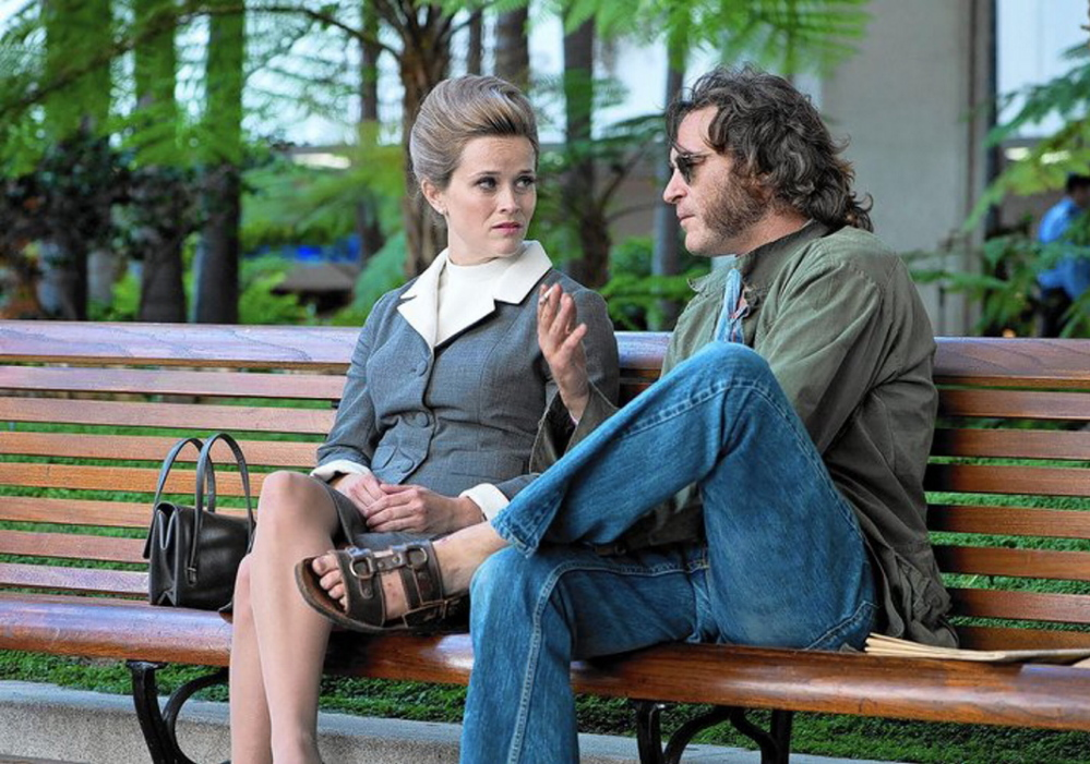 "Reese Witherspoon as Penny Kimball and Joaquin Phoenix as Doc Sportello in ""Inherent Vice."""