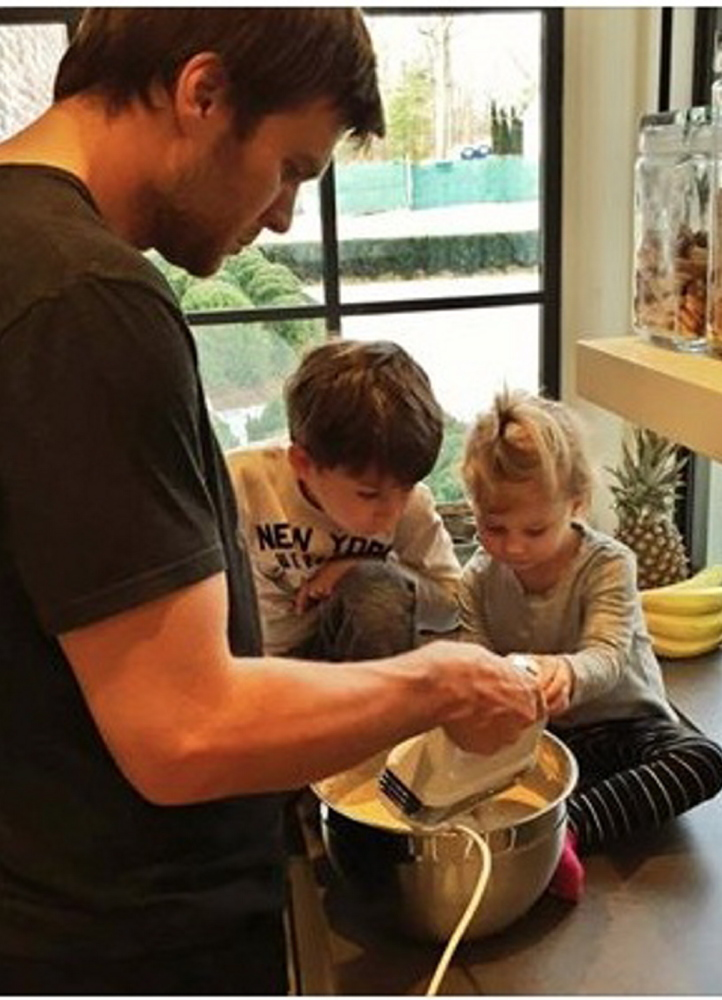 "Tom Brady promotes healthy ""gender norms"" by making pancakes with his children in a snapshot posted on Facebook."